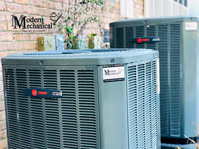 two outdoor hvac units with logo